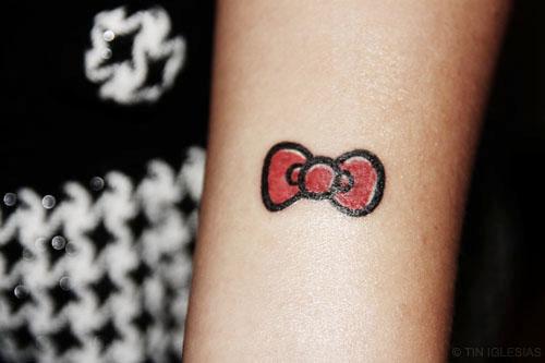 Small-Hello-Kitty-tattoo-on-forearm