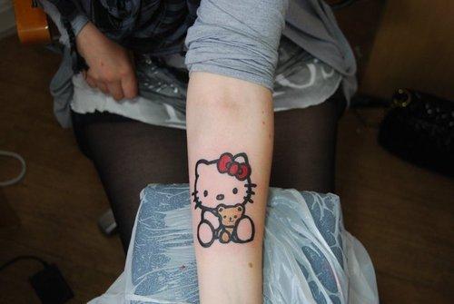 kawaii hello kitty tattoo arm